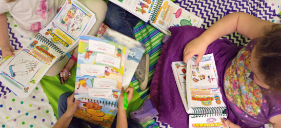 Children reading work books