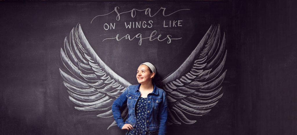 Chalk board drawing soar on wings like eagles